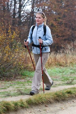 Young female hiking in the forest. Fall time Standard-Bild
