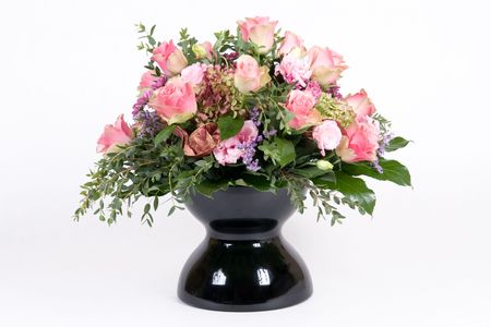 Beautiful bouquet with pink roses in black vase