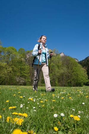 Young woman is hiking in Slovakia. Beautiful spring day