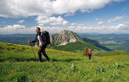 Couple is hiking in mountains, Mala Fatra, Slovakia. Velky Rozsutec in background photo