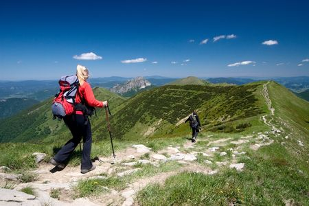 Couple is hiking in mountains, Mala Fatra, Slovakia. Velky Rozsutec in background