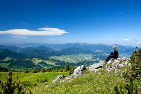 Girl is relaxing during climbing to Velky Chocz Peak, Slovakia Standard-Bild