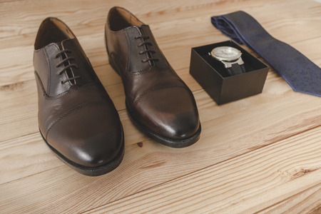 Shoes, tie and dress accessories elegantly Фото со стока