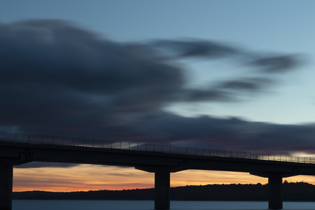 Nice sunset after a viaduct crossing over a lake Stock Photo