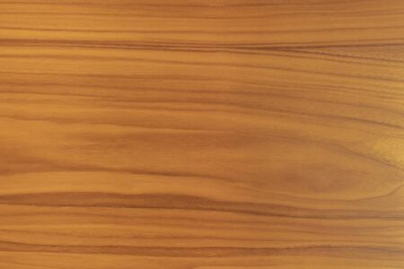 Background or texture of treated brown wood, where you can see the grain of the wood