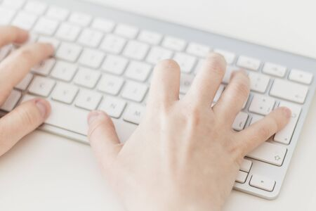 Close Up, Caucasian woman's hands typing on a wireless keyboard. Concepts, selective focus Archivio Fotografico