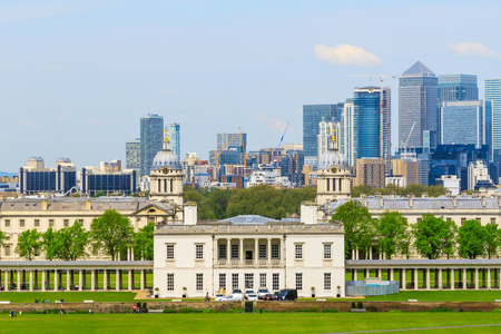 gentrification: View of Canary Wharf and Greenwich University from Greenwich hill of London, England, UK