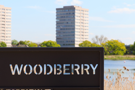 gentrification: Sign for  the newly-opened Woodberry wetlands nature reserve at Woodberry Down in London on a sunny day Stock Photo