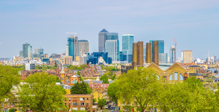 gentrification: View of Canary Wharf from Greenwich hill of London, England, UK