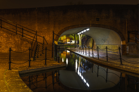 Albion Channel under a path bridge, an ornamental canal created linking Canada Water to Surrey Water