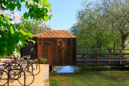 gentrification: London, UK - 04052016 - Rust architecture design of entrance for the newly-opened Woodberry wetlands nature reserve at Woodberry Down in London