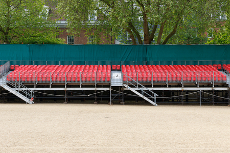 spectator: Temporary outdoor raked red spectator seating