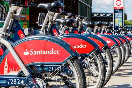 boris: London, UK - May 23, 2016 - Santander rental bikes for hire outside St. Pancras station, also known as Boris bikes after the Mayor of London. Editorial