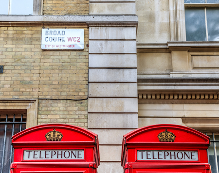 covent: The iconic red telephone booths and street sign on Broad Court, Covent Garden, London