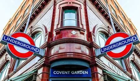 London, UK - June 6, 2016 - Covent Garden station and iconic signs for the London�s underground transpiration system. Covent Garden in Londons West End is a popular destination for visitors and Londoners.