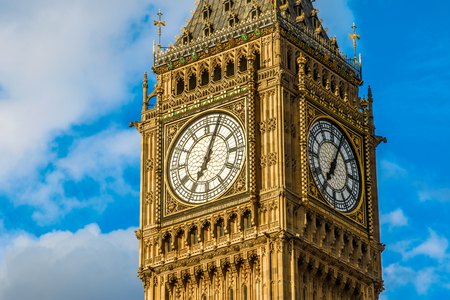 chiming: Closeup of the clock face of Big Ben in London