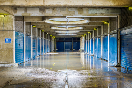 Flooded pedestrian underpass in Golden Lane Estate, a 1950s council housing complex in the City of London.