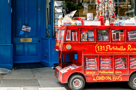 portobello: London, UK - July 13, 2016 - Red double decker model filled with English souvenirs on Portobello Road in Notting Hill