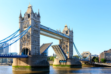 Tower Bridge in London with drawbridge open on a cloudless day Stock Photo