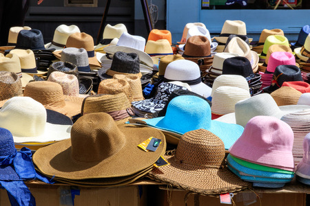 bric: Variety of sun hats displayed in a street market