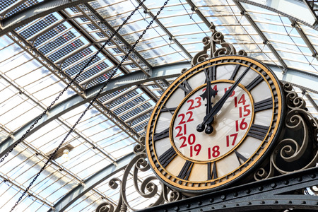 Old-fashioned style clock at Kings Cross train station in London