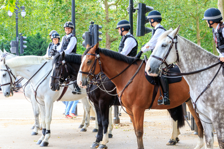 mounted: London, UK - July 15, 2016 - Mounted Police officers patrol on London streets