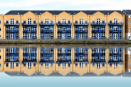 Terraced houses along Millwall Outer Dock in London, UK