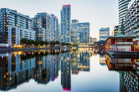 Illuminated buildings in Canary Wharf, financial hub in London at evening Stock Photo
