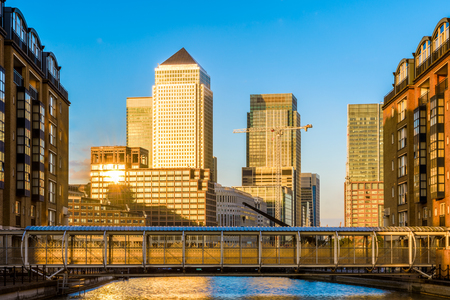 Canary Wharf, financial hub in London at sunset seen from Nelson Dock Pier