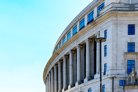 frontage: Unilever House, a office building in the Neoclassical Art Deco style with a curving frontage against a blue sky in London Editorial