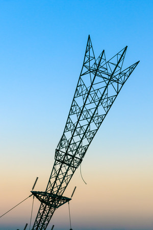 is cloudless: Upside down electricity pylon in Greenwich, London against a sunset cloudless sky