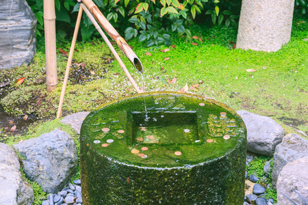 water feature: Oriental water feature in Holland Park in west London Stock Photo