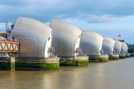 downstream: Thames Barrier, located downstream of central London