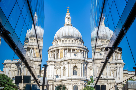 St Pauls Cathedral and its reflection from glass walls of One New Change building in London Editorial