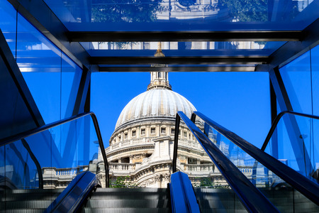 St Pauls Cathedral seen from an escalator exiting from One New Change building in London