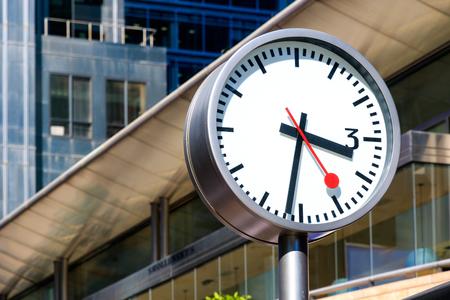 wharf: Public clock in Canary Wharf, financial district in London