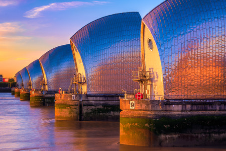 Thames Barrier, located downstream of central London at sunset Reklamní fotografie - 64959606