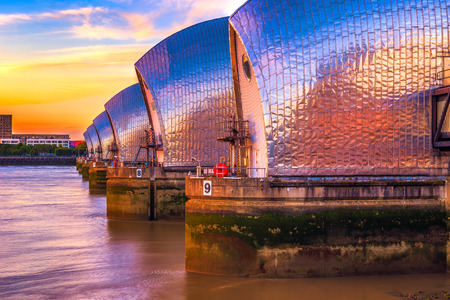 downstream: Thames Barrier, located downstream of central London at sunset