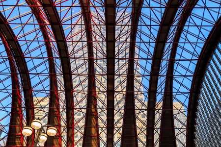 London, UK - August 30- 2016 - Glass ceiling of Canary Wharf Docklands Light Railway station