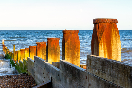 groynes: Wooden groynes to protect the sea coast at Southwold beach, UK