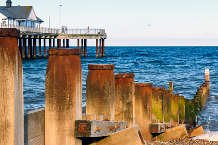 groynes: Wooden groynes to protect the sea coast and pier at Southwold beach, UK