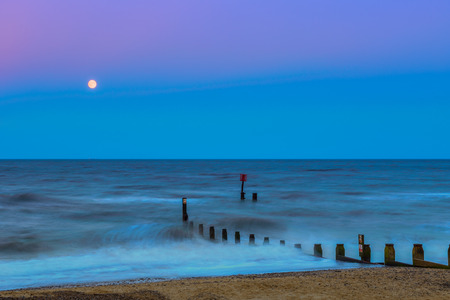 groynes: Southwold beach at sunset with wooden groynes