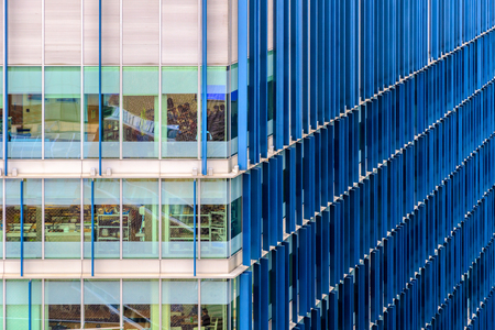 background texture metaphor: Modern office building with blue fin pattern