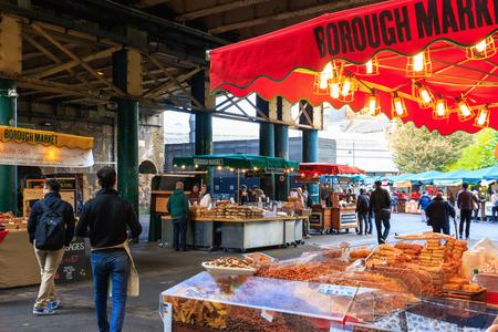 London, UK - November 7, 2016 - Tourists and food stalls at Borough Market