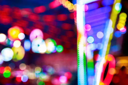 Blurred lights of a funfair for background use Stock Photo