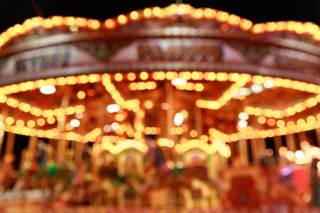 turnabout: Blurred merry-go-round in Winter Wonderland for background use Stock Photo
