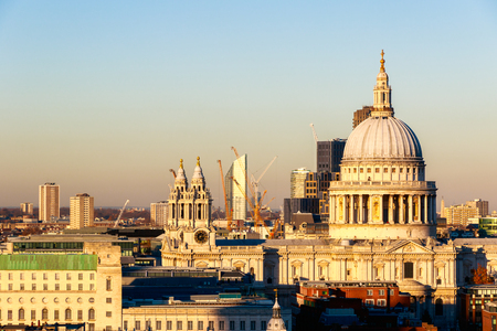 st pauls: Sunset at St Paul's Cathedral in London against a cloudless sky Stock Photo
