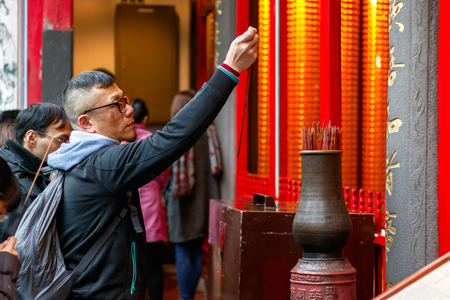 formosa: Taipei, Taiwan - January 21, 2017 - A man drawing a Chinese Fortune Stick at Lungshan Temple of Manka