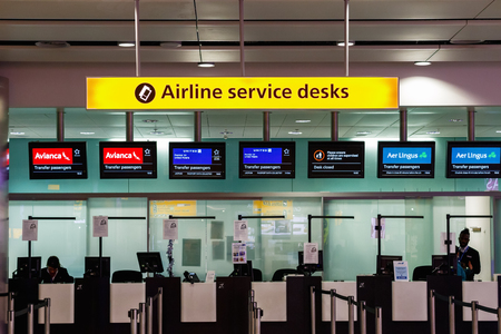 London, UK - December 24, 2016 - Airline services desks for transfer passengers at Heathrow Airport