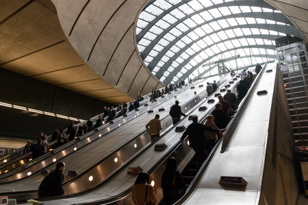 London, UK - March 27, 2017: Canary Wharf tube station during the rush hour with many commuters